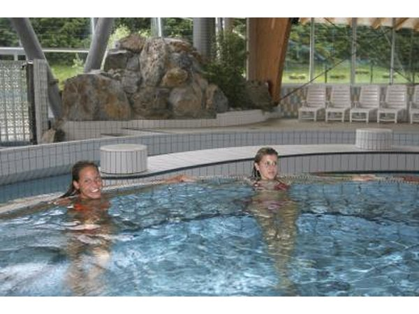 Two women in large indoor hot tub