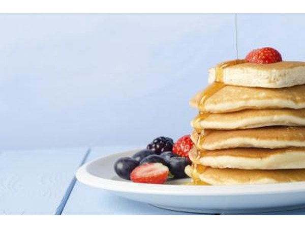 Stack of pancakes topped with berries.
