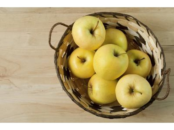 Golden Delicious apples are large, firm and green or golden in color.