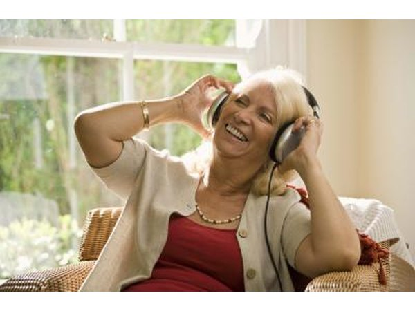 Mature woman wearing headphones