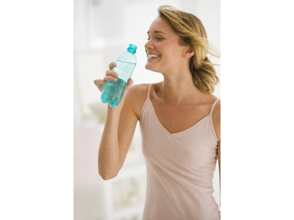 Woman drinking a bottle of water