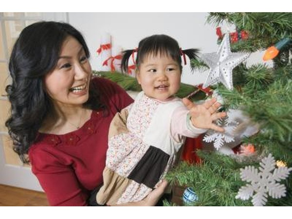 Mother and child next to tree with ornaments