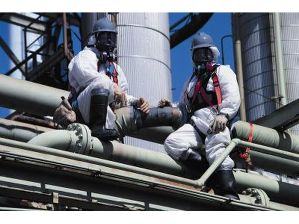 Asbestos removal team at industrial site