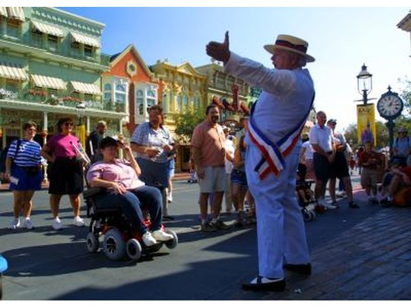Guest listen to actor on Main Street USA at Disney's Magic Kingdom