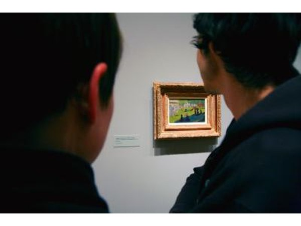Men looking at Georges Seurat painting in muesum