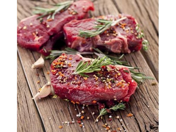 Raw filet mignon with herbs and spices
