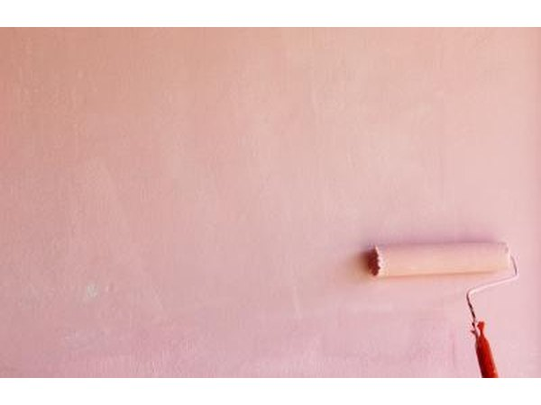 Painting a wall pink.