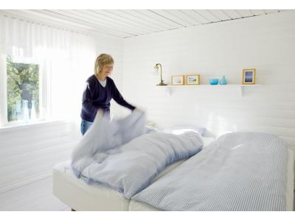 Woman looking at bedding