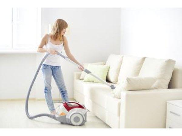 Vacuuming sofa
