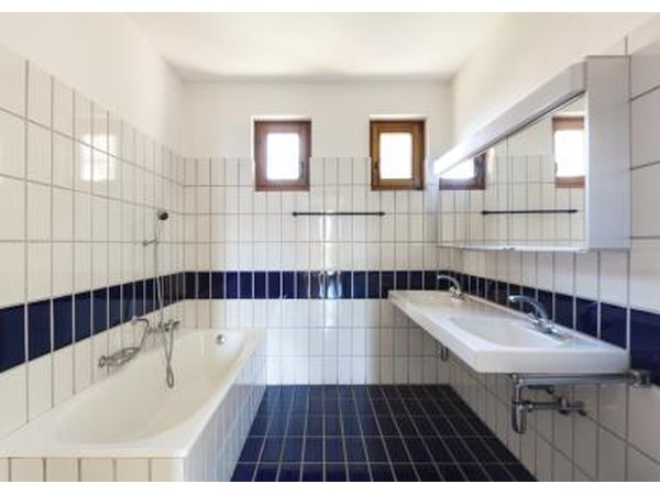 Accent your bathroom with navy blue tiles.