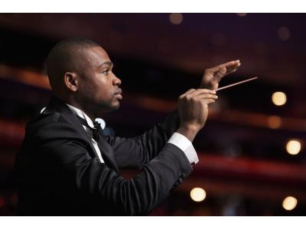Conductor leading an orchestra