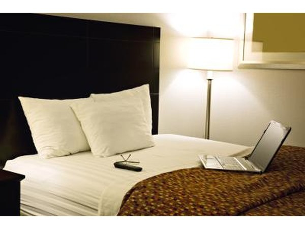 Computer on hotel bed
