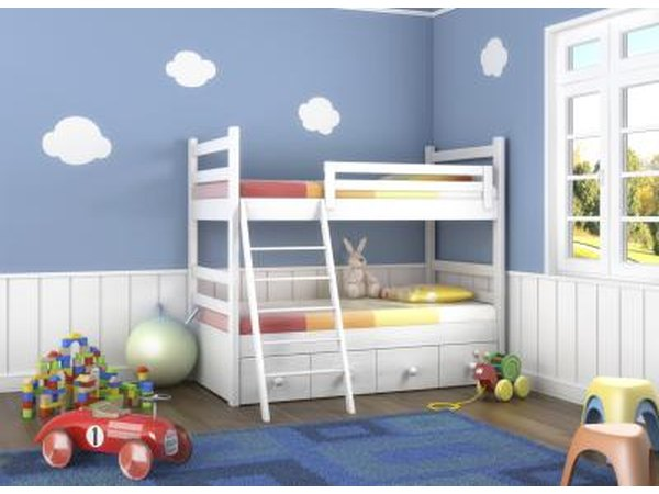 Kid's bedroom with large furniture against wall.