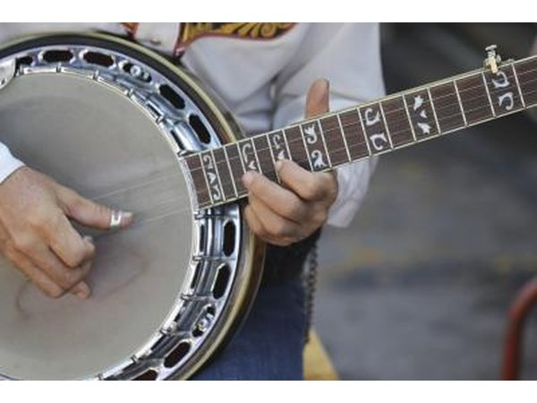 Close-up of somebody playing the banjo.