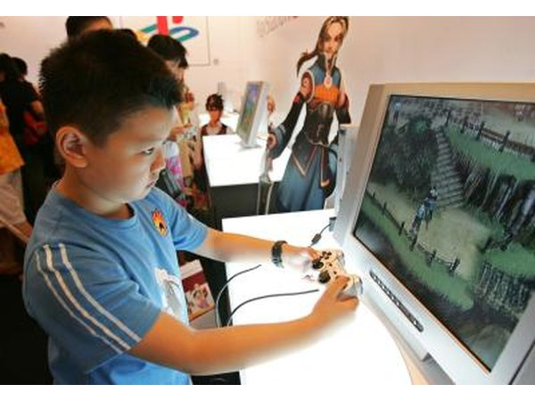 Young boy playing with PlayStation 2 game system