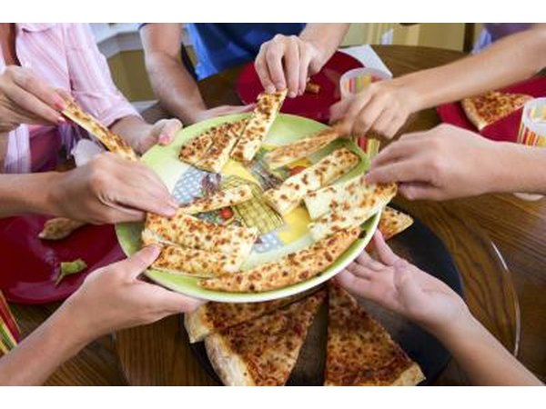 Group of friends sharing pizza
