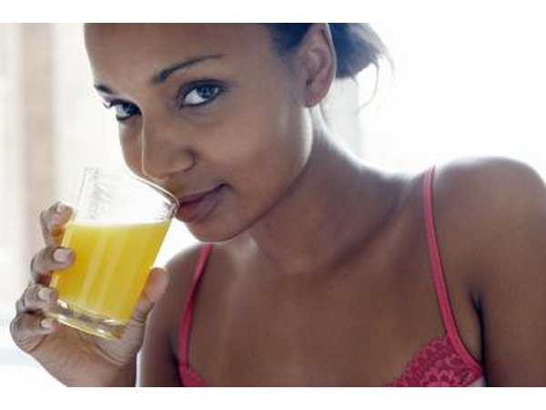 woman drinking pineapple juice