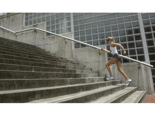 Woman jogging up stairs.