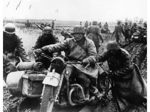 German motorcyclist bogged down in mud near Athens, Greece in May 1941