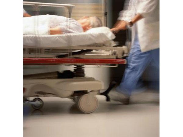 Older man being rushed through Emergency Room