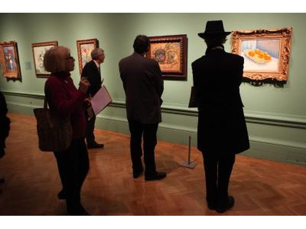 People viewing artwork done by Dutch master Vincent Van Gogh