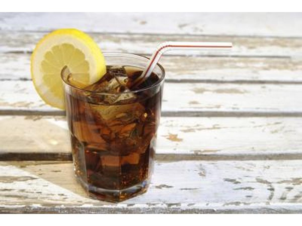 Glass of soda with lemon and straw
