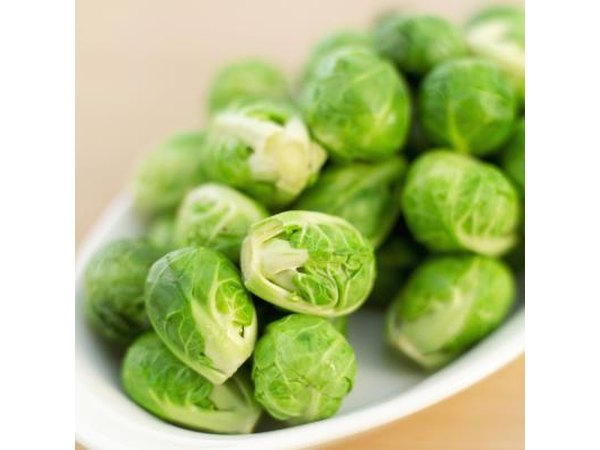 A plate of fresh brussels sprouts.