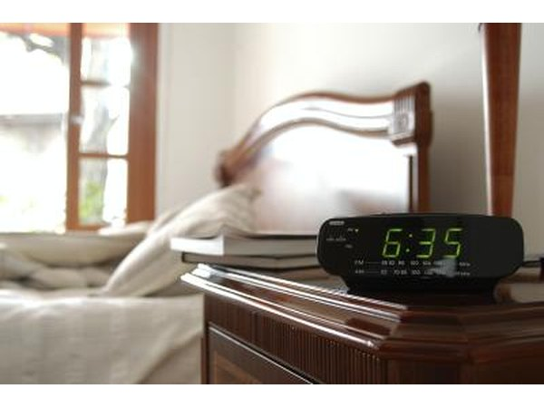 Alarm clock next to bed.