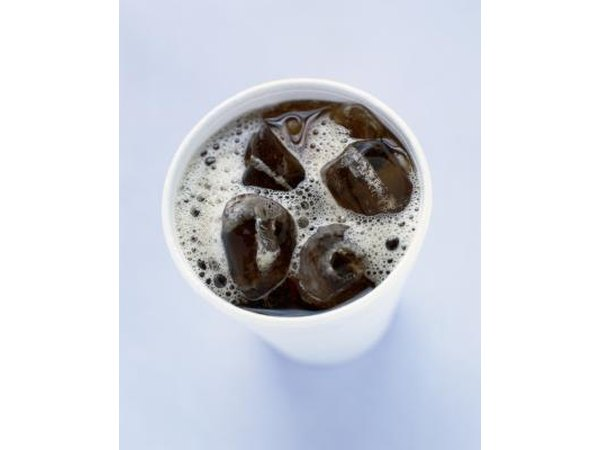 A cup with cola and ice.