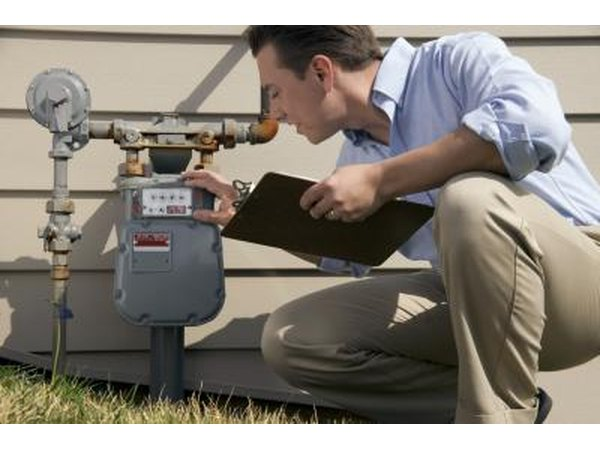 man inspecting water meter