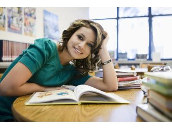 student looking at new book