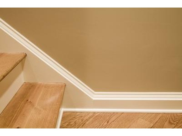 Use molding and paint to create stairway baseboards.