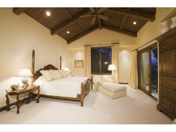 Recessed lighting shows off a vaulted ceiling to great effect.