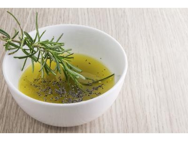 A small bowl of olive oil and rosemary.