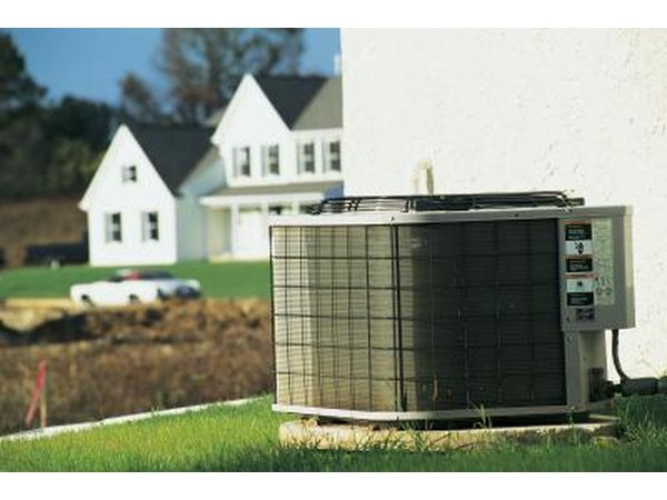 Place a tree near the air-conditioning unit to provide cooler air for the intake.