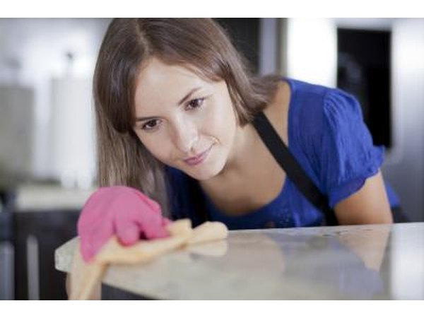 Woman cleaning counters