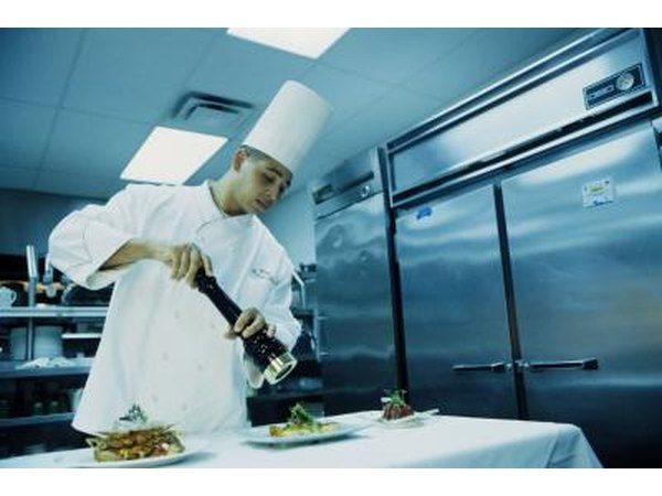 Chef working in front of a large refrigerator