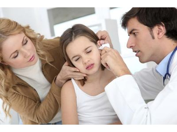 Doctor checking a child for an ear infection