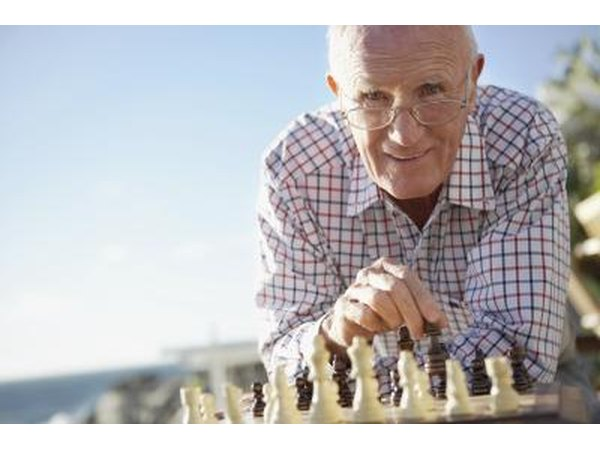 Senior citizen playing chess.