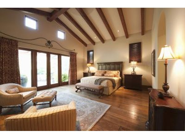 A bedroom with wood beams for support.