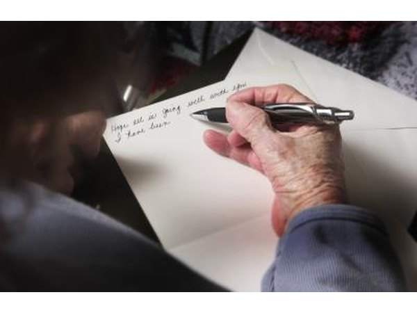 Senior citizen writing on new stationary