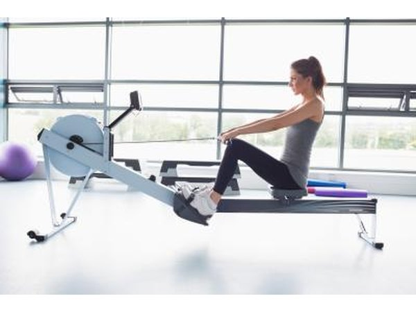 A woman is using a rowing machine at the gym.