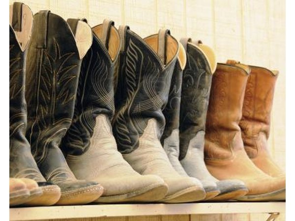 Shelf of dusty cowboy boots