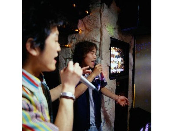 Two men singing at a karaoke bar