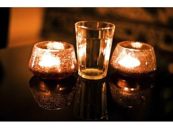 Floating candles in chocolate brown glasses will create a beautiful night time effect