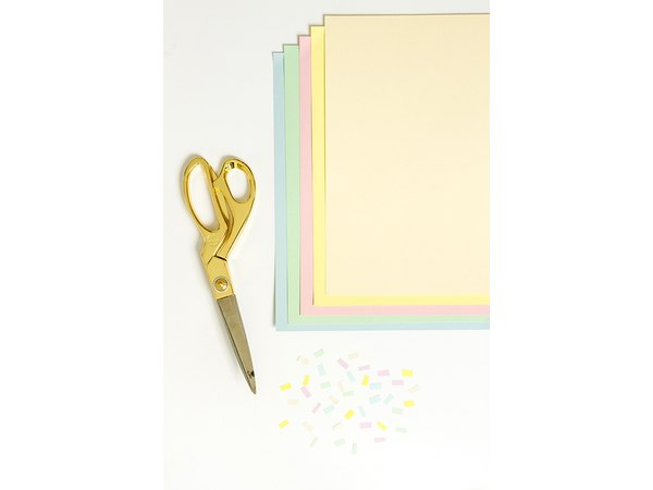 Cut colorful cardstock paper to look like sprinkles, and glue it on the cotton balls.