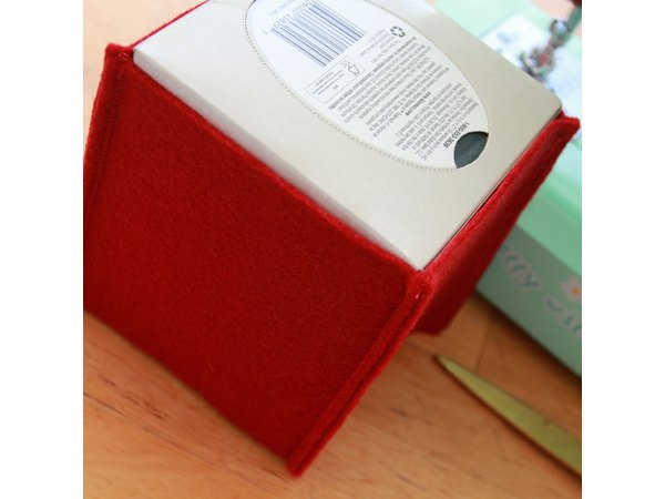 The sewn felt walls should fit snugly around your tissue box.