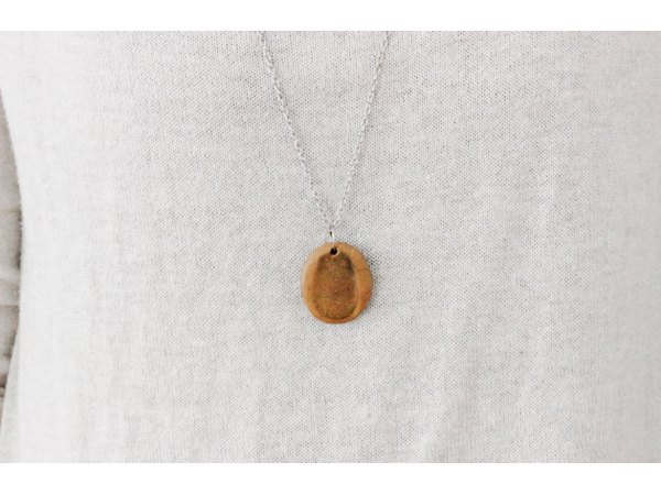 Make a momento from a special someone with a clay thumbprint necklace.
