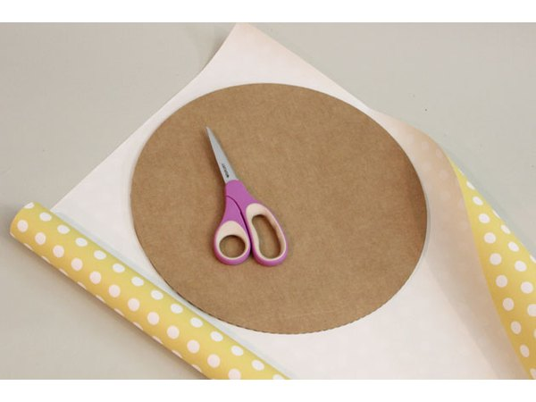 Cover the cake round with coordinating paper.
