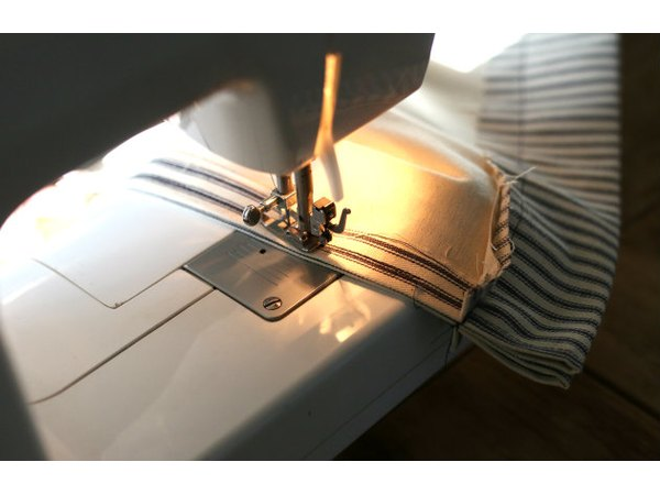 Most sewing machines have a backstitching setting for a quick back and forth along the fabric edge.